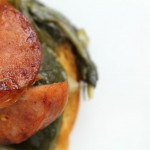 Crostini with Sausage and Braised Greens