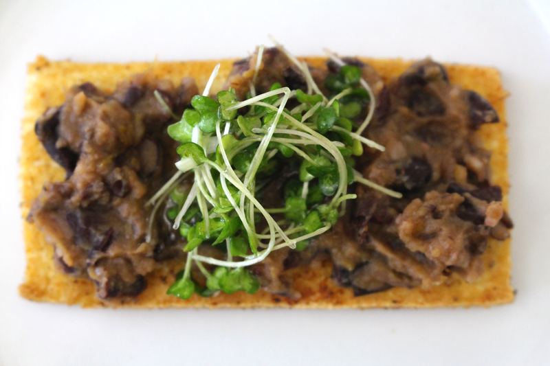 Crispy Tofu with Black Bean Purée and Microgreens